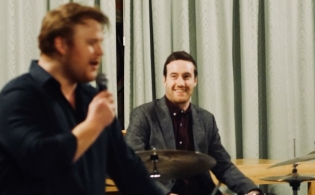 Ben singing and Ollie on drums in Reigate