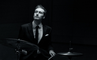 Ollie Howell on drums